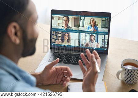 Latin Indian Businessman Having Virtual Team Meeting Group Call Chatting With Diverse People In Cust