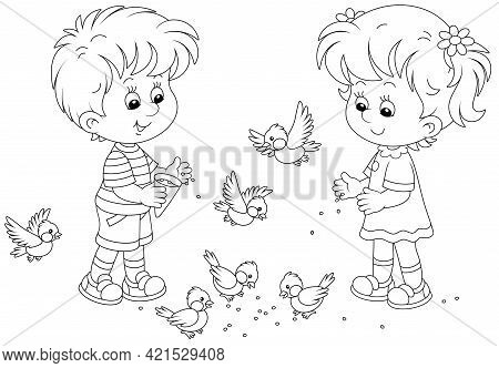 Happy Little Children Feeding With Corn A Small Flock Of Merry Sparrows And Titmice, Black And White