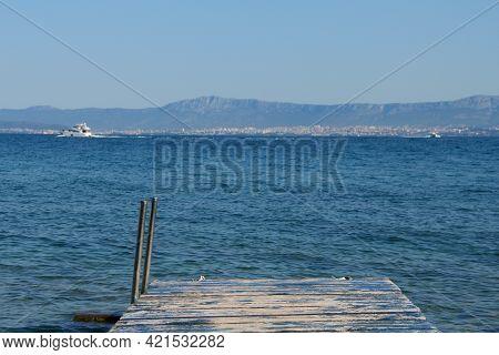 Wooden Jetty Over Turquoise Sea Water, Supetar, Brac Island, Croatia