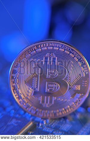 Bitcoin Coin On On Computer Motherboard, Cryptocurrency Investing .bitcoin.silver Bitcoin On Electro