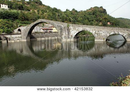 Ponte della Maddalena across the Serchio. Tuscany. Bridge of the Devil poster