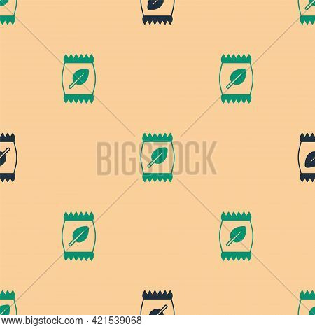 Green And Black Fertilizer Bag Icon Isolated Seamless Pattern On Beige Background. Vector