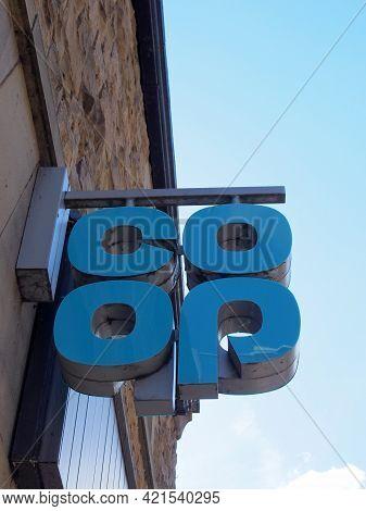 Hebden Bridge, West Yorkshire, United Kingdom - 22 May 2021: Sign Above A Coop Supermarket In Hebden