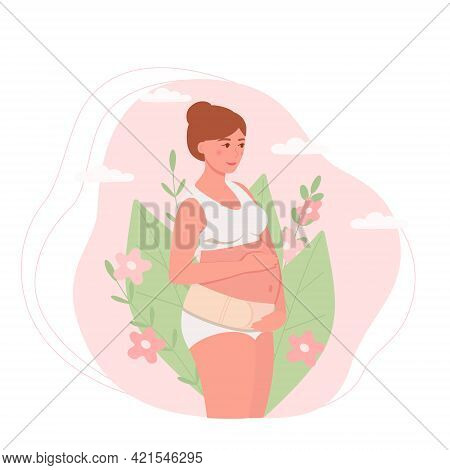 A Pregnant Woman With A Bandage Supporting Her Stomach On A Background Of Leaves. The Concept Of Hea