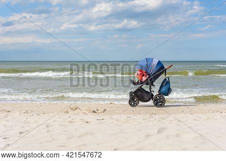 Stroller On The Sandy Beach At Baltic Sea