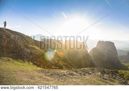 A Woman Enjoy The Sunset In The Valley Over Meteora, Greece