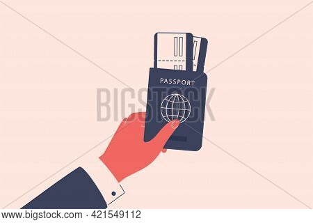 Male Hand Holds A Passport With The Boarding Pass Or Flight Ticket. Man Gives The Document Allowing