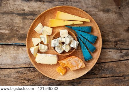 Top View Of Set Cheese Board On Wooden Background
