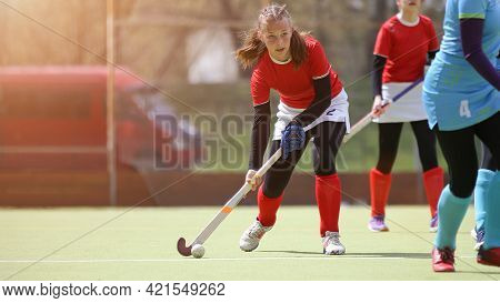 Teenage Field Hockey Player In Attack With Ball
