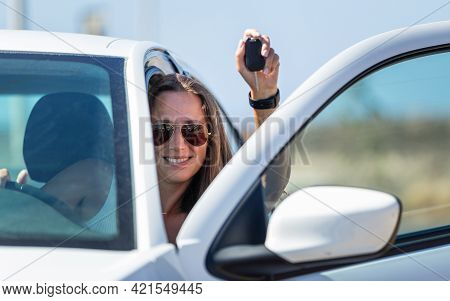 Young Happy Driver Woman With Car Key In Her Hand