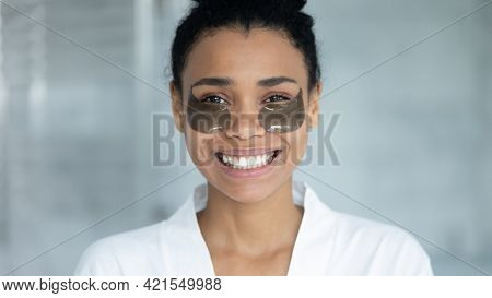 Head Shot Of Happy Black Girl With Hydrogel Collagen Patches