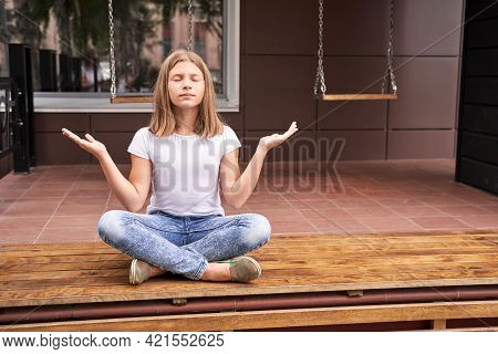 Girl Sitting Outdoors. One Person Class Retreat. Training Soul. Lotus Position. Yoga Meditation Conc