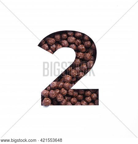 Number Two Of Nutritional Chocolate Cereal Balls, White Cut Paper. Second Numeral. Typeface For Heal