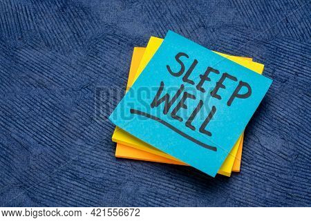 sleep well reminder, advice or wish, handwriting on a reminder note, healthy lifestyle concept