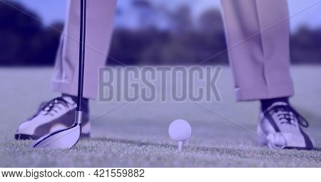 Composition of low section of male golf player with club and golf ball in golf course. sport, fitness and active lifestyle concept digitally generated image.