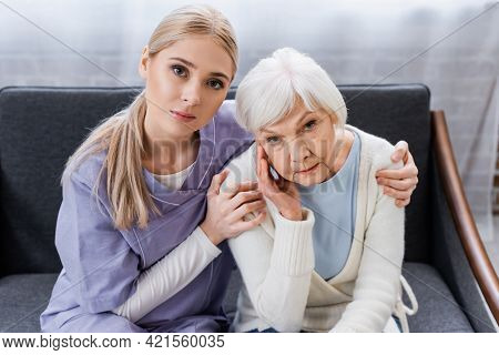 Social Worker Hugging Elderly Woman Sick On Dementia.