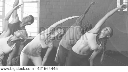 Composition of group of men women stretching exercising in fitness class in black and white. sport, fitness and active lifestyle concept digitally generated image.