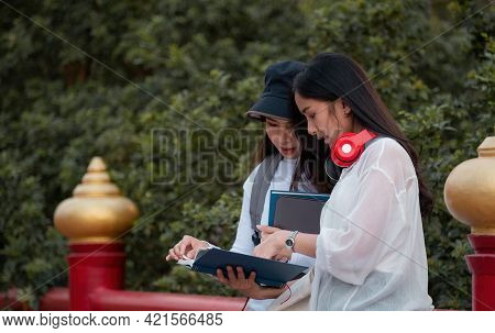 Group Of Young People Reading A Book, School Folders Reading Book At High School University Campus C