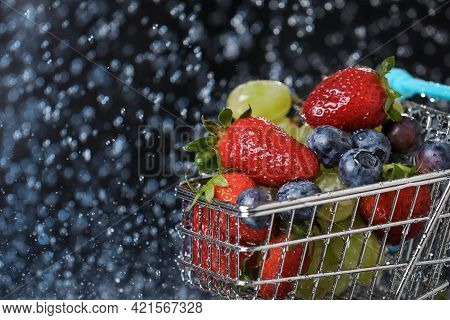 Close Up Of Blue Shopping Box With Fruit Salad. Blue Shopping Cart With Strawberry, Grape, Blueberry