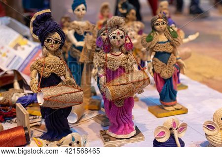 Handmade Puppet Models Of Musicians And Dancers With Traditional Costumes Made Of Jute Isolated On B