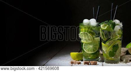 Fresh Made Mojito Cocktail On Dark Background. Summer Drinks Concept.