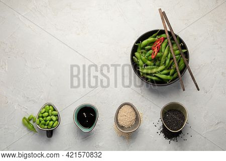 Raw Edamame Soya Beans With Salt And Sauce On Light Gray Background.