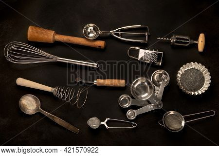 Set Of Kitchen Utensils On Black Background. Tools For Cooking.