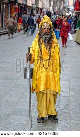 KATHMANDU, NEPAL - CIRCA MARCH 2013: Full length portrait of a sadhu.