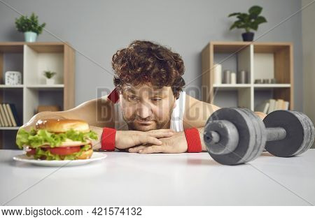 Funny Sad Chubby Man Choosing Between Gym Dumbbell And Delicious Unhealthy Burger