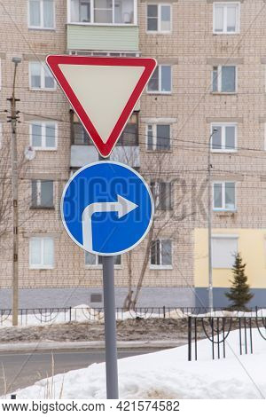 Traffic Signs Mean Give Way And Turn Right Only At The Edge Of The Road. Against The Background Of A