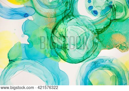 Abstract Ink Blue, Green And Yellow Watercolor Ink Drops Background. Alcohol Ink Illustration.