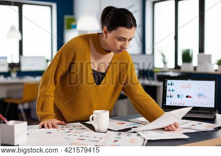 Project Leader Preparing Presenstation For Investors Using Printed Charts. Executive Entrepreneur, M