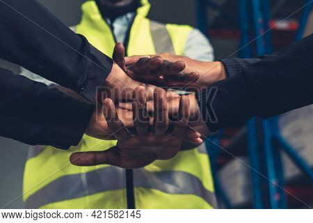Factory Workers Stacking Hands Together In Warehouse Or Storehouse . Logistics , Supply Chain And Wa
