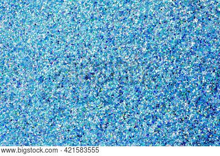 Blue shiny glitter textured background