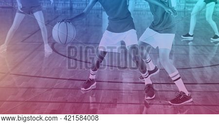 Composition of group of fit basketball players playing match over light blur. sport, fitness and active lifestyle concept digitally generated image.