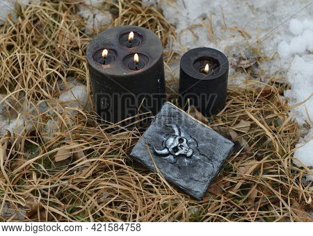 Black Candles And Witch Diary Book Of Magic Spells In Grass Outside. Esoteric, Gothic And Occult Bac