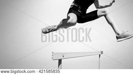Composition of athletic man jumping on white background. sport, fitness and active lifestyle concept digitally generated image.