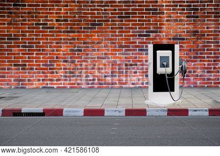 Electric Chargers Machine For Electric Vehicles (ev) Are Installed On Roadside Of Footpath, To Incre