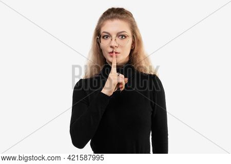 Young Slim Woman Looking Serious And Cross With Finger Pressed To Lips Demanding Silence Or Quiet, K
