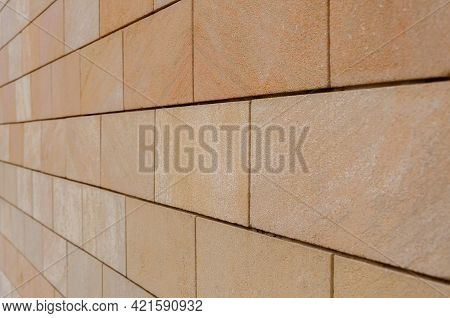 Modern Sandstone Facade Cladding. Brown Wall Tiles Imitating Brickwork. Modern Finishing Material. C