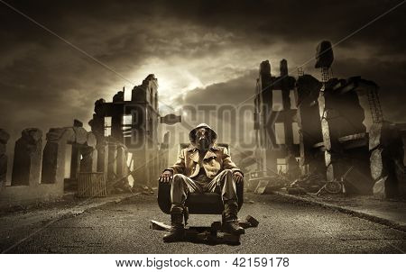 Post apocalyptic survivor in gas mask destroyed city in the background poster