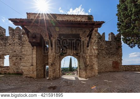 Arched Medieval Gate With Drawbridges At The Entrance To The Castle Of Brescia. Lombardy, Ital
