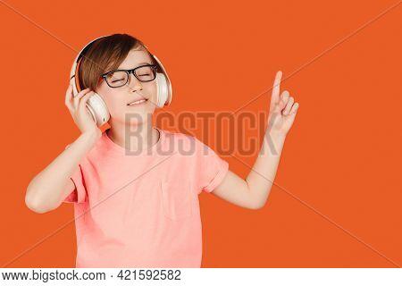 Cute Teen Boy Listening Music In Headphones. School Child Listening Loud Music In Wireless Earphones
