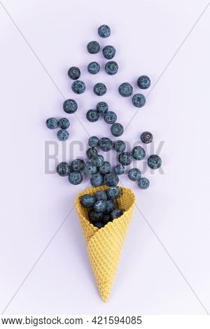 Ice Cream Cone With Blueberries. Blueberry Icecream. Healthy Summer Food Concept