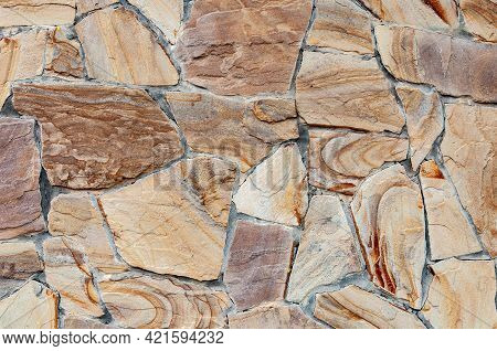 Rainbow Sandstone. Clastic Sedimentary Rock Composed Mainly Of Sand-sized Silicate Grains. Stone Wal