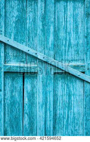 The Background Of The Old Painted Boards. Grunge Light Blue Painted Wooden Textured Background. Wood