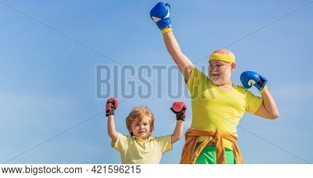 Little Boy Sportsman At Boxing Training With Coach. Sports Man Coaching Boxing Little Boy In Red Box