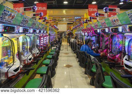 Okinawa, Japan - June 10,2019 : Unidentified People Plays An Arcade Machines In Jumbo Pachinko Arcad