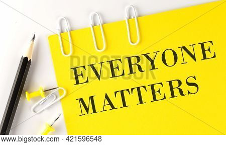 Everyone Matters Word On The Yellow Paper With Office Tools On The White Background