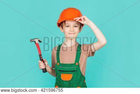 Little Builder In Helmet And Hummer. Child Dressed As A Workman Builder. Little Boy Wearing Helmet.
